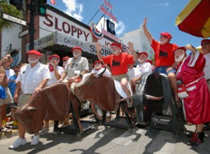 Ernest Hemingway look-a-likes running of the bulls outside Sloppy Joe's Bar. Photo from Reuters.